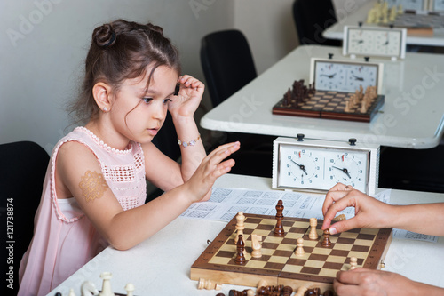 Poster little girl playing chess