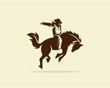 Cowboy riding wild horse - 121761883