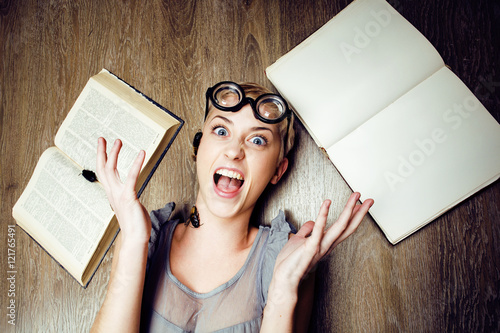 portrait of crazy student girl in glasses with books and cockroaches, concept of Poster