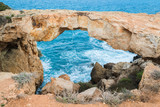 Natural Rock Bridge at Cape Greco near Ayia Napa in the evening light. Cyprus