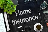 Home Insurance on Black Chalkboard. 3D Rendering.