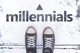Millennials concept with pair of sneakers on the pavement