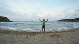 Man Jumping For Joy on the Beach Celebrate Win