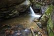 waterfall on river between boulders