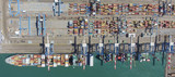 Commercial port with container ship - Aerial photo