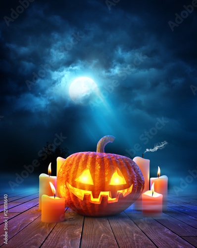 Halloween night, Jack O Lantern pumpkin with glowing candles on a moonlit evening. 3D illustration.