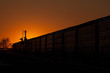 Silhouette of Railway Auto Cars Against Golden Sunset
