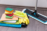 house cleaning equipment and accessories on the laminate floor