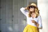 Beautiful female. Close-up portrait of mature woman enjoying summer sunshine while standing outdoor.