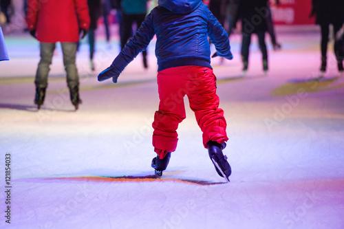Fotobehang Wenen Child ice skating at night in Vienna, Austria. Winter.