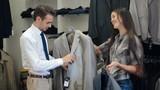 Man choosing a jacket at store
