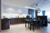 Interior of a high tech kitchen with  a table and chairs - 121872412
