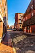 Cobblestone street and old brick buildings in the waterfront area
