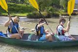 Happy family ready for canoe