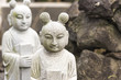 Two stone Asian statue on the Jeju island in South Korea