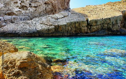 Coast of Ibiza, the sea and the rocks.