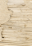Wooden slats pathway at the yellow sand beach