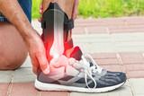 Man wearing ankle brace - 121955403