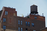 New York City water tower on top of brick apartment building