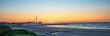 Sunrise on Galveston beach with pier