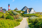 Fototapety Road to lighthouse in Hornum village on southern coast of Sylt island, Germany