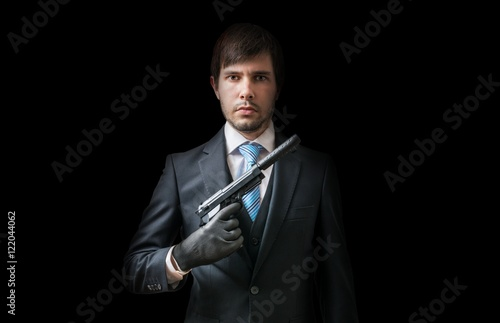 Hitman or murderer with pistol with silencer on black background Poster