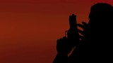 A man (male cop, detective) carefully checking the place with a gun. Silhouette shot on red background.