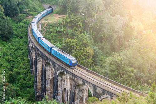 Poster Train goes over bridge