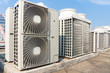 Industrial air conditioner condensers (outside unit) on the roof of a building on a hot summer day