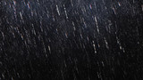 Fototapety Falling raindrops footage animation in slow motion on dark black background with fog, lightened from top, rain animation with start and end, perfect for film, digital composition, projection mapping