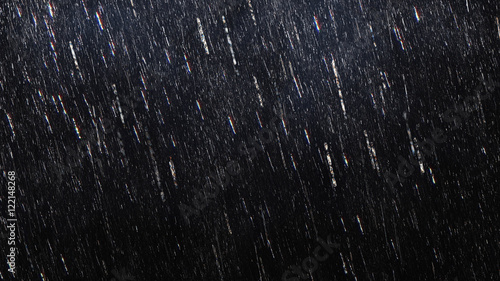 Falling raindrops footage animation in slow motion on dark black background with fog, lightened from top, rain animation with start and end, perfect for film, digital composition, projection mapping - 122148268