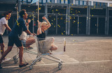 Fototapety Friends racing with shopping cart