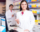Portrait of pharmacist and assistant working