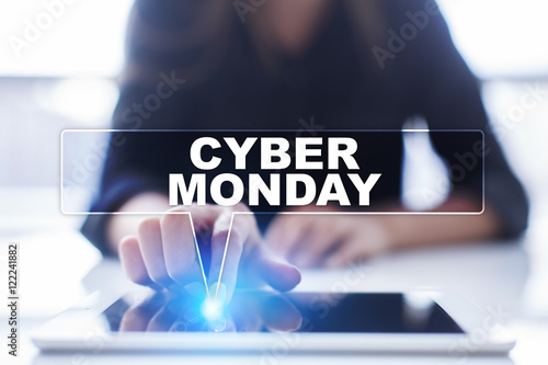 """Woman is using tablet pc, pressing on virtual screen and selecting """"Cyber Monday""""."""
