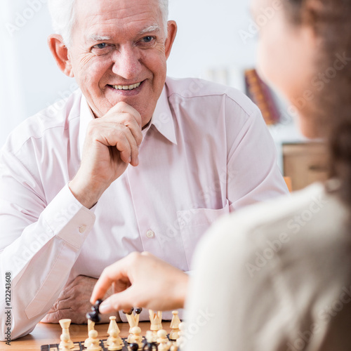 Poster Senior man playing chess