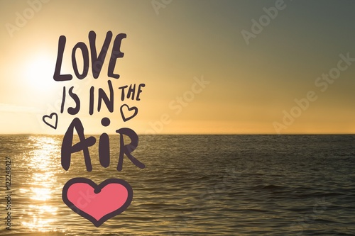 love is in the air text on sea background