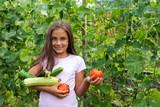 Little girl in veget...