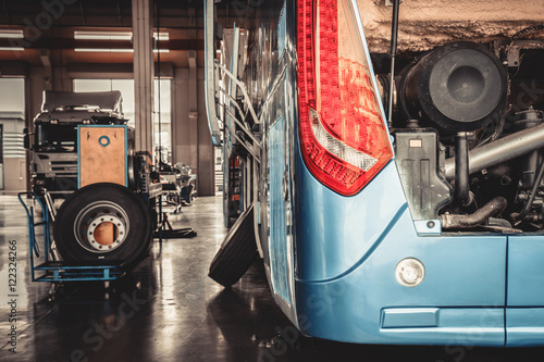Fototapeta bus and truck waiting for service in the garage, vintage photo a