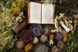 Fototapety Book and Herbal medicine on wooden table background