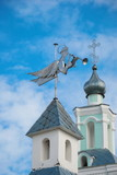 Weather vane in the form of an angel with a trumpet on the monastery tower