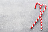 Candy cane. Christmas decors with gray background.