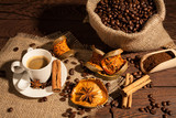 Fototapety Coffee cup with cinnamon, star anise and dried orange fruit