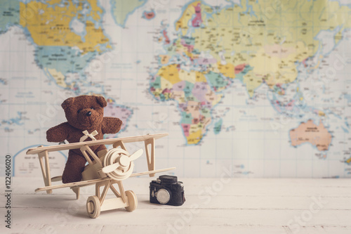 teddy bear and wooden toy airplane against with copyspace Poster