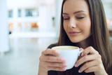 Elegant woman in a coffee break