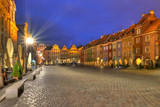 Night photo of Poznan  Old Market in Poznan with colorful, illuminated townhouses.