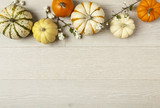 Miniature pumpkins on rustic wood background. Simple, natural country style fall autumn decorations. - 122452877