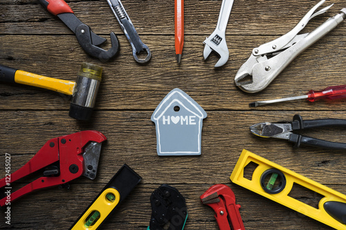 DIY home and construction tools on a wooden background