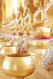 Golden monks alms bowl and golden buddha statue at Paknam Jolo Temple, Bangkhla, Thailand