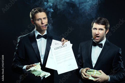 Two typical Mafioso with cigars showing contracts and money Poster