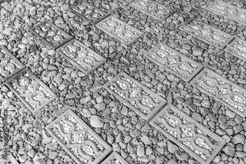 Walkway surface made of gravel grainy , stone and bricks for bac Poster